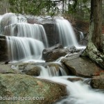 Water cascades off a ledge on its way to the sea. Acadia National Park.