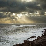 Dark storm clouds with rays of sun over a stormy ocean Acadia National Park