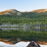 Tranquil reflection of Bald Peak in the late afternoon, Acadia National Park
