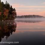 Steam rising off a lake at dawn, Acadia National Park