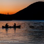 Couple canoeing in the evening, Jordan Pond, Acadia National Park, Maine