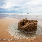 Cylidrical Stone miles down a deserted beach, Ocean Beach, Hawkes Bay, New Zealand
