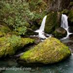 Water splits around a rock at Wye Creek, Queenstown, New Zealand