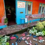 Grade School in the Philippines.  Doorstep filled with children's flip-flops.