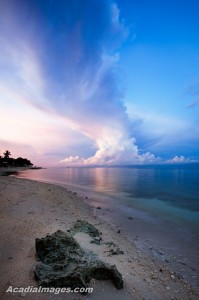 Clouds sweep across the dawn sky at Moalboal, Philippines.